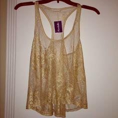 LAST CHANCE Gold lace shirttail tank Small S NWT NWT. Size small. Purchased from Marshalls. Sheer mesh lace. Racerback style with drop arms). Would look great worn over white, nude, or brown bandeau. Tops Tank Tops