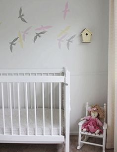 nursery wall decorating with birds images in light gray and pink colors