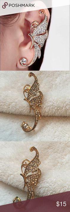 Butterfly Ear Climber Gold alloy hypoallergenic butterfly ear climber. Featuring a single butterfly adorned with clear colored rhinestones. These are a clip on style ear climber that fastens to the lobe and the upper portion of the ear. The perfect addition to any outfit, a great piece of fashion jewelry!! Gorgeous!! Jewelry Earrings
