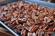 One of our favorite snacks and a perfect little nibble for the holidays, tailgating events, or other parties are these simple roasted pecan halves. They really are so simple to make that I'm not sure I should even call it a recipe. I had never thought of including them here on my blog because they are so simple, but then a friend called me the other day and asked me how I made them. A few days later we made a big sheet pan of roasted pecans for my husband to take with him to the local colleg