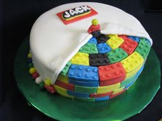 Thanks to others from this site for the idea for this cake. Cake covered in MMF; used a mold to shape the Lego blocks.
