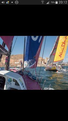 Volvo ocean race practice.  Left is womans boat. Unbelievable nice shot