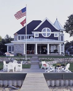 Red-and-white-striped cushions on outdoor furniture take color and pattern direction from the flag overhead.