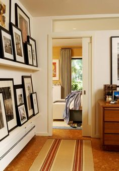 lotsa pictures but tidy on picture rails #art #framing #collections