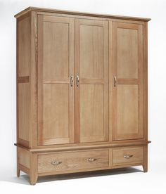 Sherwood Oak Triple Wardrobe with Two Drawers The Sherwood Oak furniture range is a substantial, high quality collection, which would bring a contemporary flourish to a multitude of interiors. Solid, light oak is crafted into sophisticated pieces Triple Wardrobe, Oak Wardrobe, Wooden Wardrobe, Built In Wardrobe, Wardrobe Design, Selling Furniture, Online Furniture, Oak Bedroom Furniture, Furniture Packages
