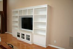 Contemporary built-in entertainment wall unit in painted Maple wood. Built In Tv Wall Unit, Wall Unit Designs, Entertainment Wall Units, E Room, Parker House, Wall Storage, Storage Bins, Built In Cabinets, Toy Rooms
