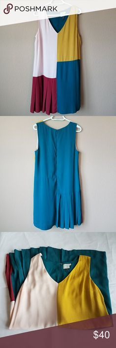 HD in Paris Jules color-block shift dress sz 12 Jules color-block shift dress size 12 teal mustard pink red size 12 light wear back zipper v neck Lined Pleats at bust front and back pleats on half of dress Anthropologie Dresses Midi Dress Colour, Colorblock Dress, Teal Colors, Anthropologie Dresses, Fashion Tips, Fashion Design, Fashion Trends, Color Blocking, Mustard