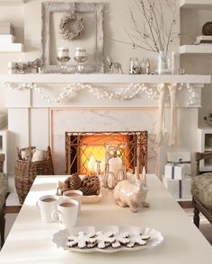 Charming Winter White Fireplace   photo Angus Fergusson   See more festive rooms and vote for your favourite space for a chance to win $ 500 from Air Wick! #contest http://houseandhome.com/design/vote-your-favourite-festive-moment