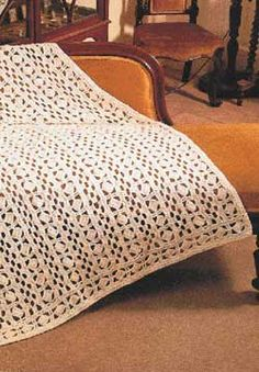 FREE crochet pattern for Beautiful afghan with lacy geometric cutouts.