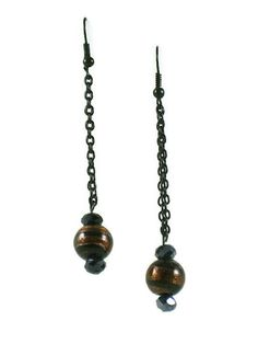 These magnificent glittery earrings are made with #GlassBeads and oval faceted #Hematite beads. They hang about 2 inches with black small link chain. #taraelisabethdesigns #Handmade #HandmadeJewelry #Jewelry #FashionJewelry
