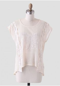 <p>Perfect for a warm-weather day, this sheer beige woven top is adorned with floral embroidery at the front and floral appliques. Finished with a high-low hem and a chiffon panel at the back, this top can be layered over a cami and paired with denim shorts for a day outdoors. Plenty of stretch.</p> <p>Self: 100% Cotton<br /> Contrast 1: 100% Polyester<br /> Contrast 2: 100% Cotton<br /> Imported<br /> 21.5
