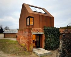 Aldeburgh Music School's Dovecote Studio designed by Haworth TompkinsDovecote Studio. The prefabricated music studio was built within the remains of an old red brick Victorian pigeon house.