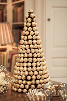 Elegant Chocolate Tower!   Gold Wedding | Gold Bridal Earrings | Gold Wedding Jewelry | Spring wedding | Spring inspo | Gold | Spring wedding ideas | Spring wedding inspo | Spring wedding mood board | Spring wedding flowers | Spring wedding formal | Spring wedding outdoors | Inspirational | Beautiful | Decor | Makeup |  Bride | Color Scheme | Tree | Flowers | Wedding Table | Decor | Inspiration | Great View | Picture Perfect | Cute | Candles | Table Centerpiece | Gold Themed Wedding | Gold…