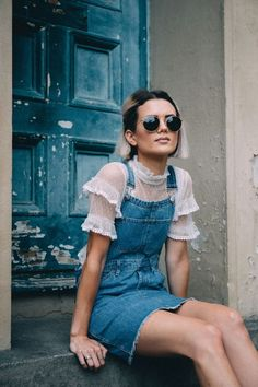 Photos via: Chloe Helen Miles  The roughness of denim combined with the femininity of sheer lace create a beautiful pairing. This blogger proved that in a denim overall dress layered over a sheer, lac