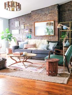 Love the charming character of this room. Eclectic use of layered rugs, textures, and color.