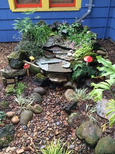 Downspout rain garden built with rocks to solve drainage problems