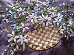 Purple embroidered cushion cover.