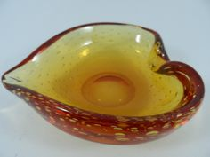 http://www.ebay.com.au/itm/Murano-Art-Glass-Tangerine-Controlled-Bubble-Heart-Shape-Ashtray-/191843253256?hash=item2caabfbc08:g:M30AAOSwbwlXBRNr
