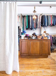 Large walk-in closet with dual level clothing racks.