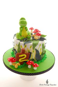 Dinosaur Cake by Little Cottage Cupcakes, via Flickr