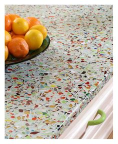Vetrazzo countertops are made from recycled glass. The Millefori color uses waste product from stained glass manufactures.