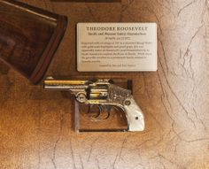 """Teddy Roosevelt's Smith & Wesson .38 Safety Hammerless - This """"Lemon Squeezer"""" is engraved with an image of TR as a mounted Rough Rider. The Smith & Wesson GOTD also has pearl grips.  The gun was reportedly given by Roosevelt to a man from a prominent family related to Spanish royalty while on an expedition in South America."""