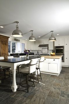 : Industrial Home Cooking Room Idea Painted In White Decorated With Metallic Pendant Light Shades On Ceiling