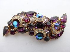 Purple rhinestone brooch with aurora borealis and gold tone crescents AJ34