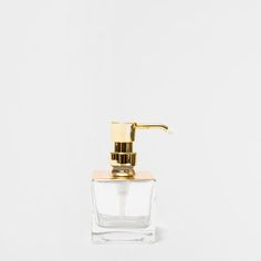 CLEAR DISPENSER WITH GOLDEN TOP