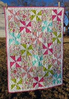 Lovin' Life At The End Of The Dirt Road: Blooming Pinwheel Quilt. Idea for quilt to make with aunt carol