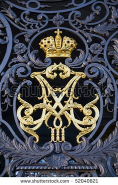 The Crown of Russian empire monogram at Hermitage museum (Winter Palace) wrought iron gate. Saint-Petersburg. Russia by Alexander A.Trofimov, via ShutterStock