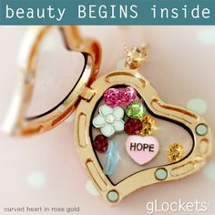 Beautiful glass heart locket necklace with personal charms & birthstones inside.