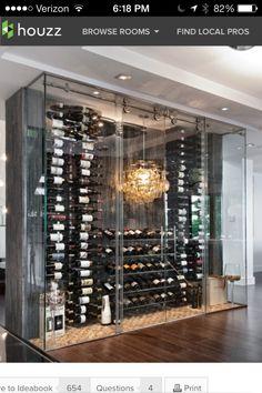 Design First Interiors glass enclosed wine fridge wall