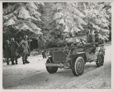 The Ardennes 1944 - Jeep carrying wounded soldier to safety.