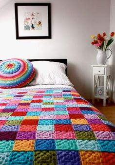 Finally, granny squares i don't have to change yarn every row...How to crochet this colorful blanket by Gloria Segura