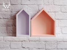 Great set of peachy and lavender house-shaped shelves.