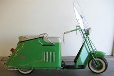 1950 Cushman Road King Scooter..GOIN' FULL BORE ON THE HIWAY AND HIT A GRASSHOPPER HEAD ON ...YOU WOULD FIND YOURSELF UPSIDE DOWN IN A HAYFIELD WITH A BUNCH OF MORMON CRICKETS IN YOUR POCKETS..