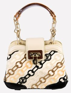 Louis Vuitton Chams Mini Linda Limited Edition Handbag BLACK CREAM GOLD BEIGES Satchel. Save 60% on the Louis Vuitton Chams Mini Linda Limited Edition Handbag BLACK CREAM GOLD BEIGES Satchel! This satchel is a top 10 member favorite on Tradesy. See how much you can save