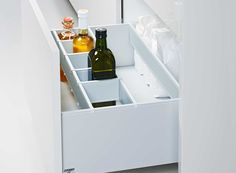 Pull-outs with bottle divider closeup #Poggenpohl #KitchenAccessories #BestOrganization