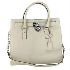 Celebrate great American fashion with the gorgeous handbag from Michael Kors. Features tanned leather exterior with strap detail across top of front and back, master lock with Michael Kors logo and hidden key inside Michael Kors logo tag, and two sets of strap, handle straps for easy carry, or a leather and silver chain shoulder strap for versatility as a shoulder bag. Snap closure opens to inside with MK logo lining, two open pockets and a zipper pocket for storage. Also includes dust bag…