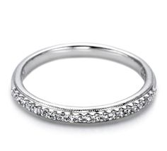 An uncomplicated, straight band with a bridge of hand-set round diamonds.  603-749-3129