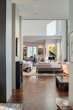 As all rooms are on one floor and many are open-plan, the walnut flooring and muted wall colour are intended to keep the design consistent throughout.