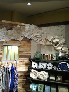 Cascading book wall from Anthropologie. What a cool idea for decorating a home library!