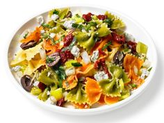 This cheerful Mediterranean Pasta Salad uses tricolor bowtie pasta and a slew of fresh Mediterranean ingredients, like feta, oregano and black olives, for a side dish bursting with bright flavor.