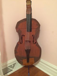 This is a cardboard cello I made for my sister. I used duct tape, brown and black acrylic paint, yarn, a pencil for the endpin, and of course thick cardboard.