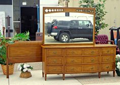 2-Piece Premium Bedroom Set Featuring Headboard and Mirrored Dresser in Excellent Condition.  Headboard: 54 x 37.  Mirrored Dresser: 75 x 20 x 71.  <b></b> at Fred's Unique Furniture. Would look good with updated hardware and feet.
