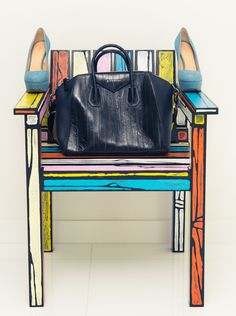 thecoveteur:  Inside the Givenchy-filled closet of one of the coolest girls in Miami.  Currently coveting: this chair.