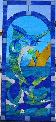Hey, I found this really awesome Etsy listing at https://www.etsy.com/listing/181960640/awesome-thrashing-marlin-stained-glass