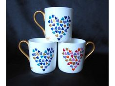 Fine, bright white 42% Bone China hand painted with hearts - his n' hers (more blue on one side, more pink on the other).  A romantic gift for Valentine's day, engagement, wedding present etc.