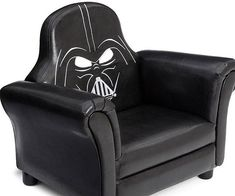 Embrace the dark side and experience its unmatched comfort by plopping down on the Darth Vader upholstered chair. With every inch covered in a durable black fabric and a back piece cleverly shaped like Vader's head, it's a must have for any Dark Jedi.
